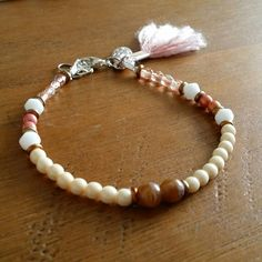 Check out this item in my Etsy shop https://www.etsy.com/listing/233527690/single-pink-and-cream-boho-summer