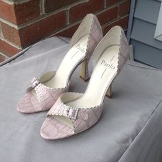 Brand new Linea Paolo heels Never worn new in box. Light pink with alligator detail. Purchased new at Nordstroms. Linea paolo Shoes Heels