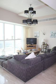 MY HOME - Living Room, L Shaped grey tweed Sofa, chandelier with shades, silver stags head, shabby chic #Dubai #apartment
