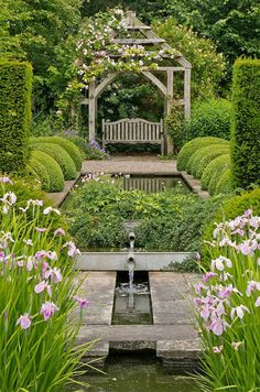 Pergola, seating, pools with a rill and falls; topiary balls and pillars to frame the view. It is the planting around the pools that makes it look lush.