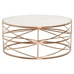 Update your coffee table with the attention-grabbing look of this Gray Manor round coffee table. The attractive rose gold color and distinct oval shape adds transitional style to your living room or s Coffee Table Next, Circular Coffee Table, Stone Coffee Table, Antique Coffee Tables, Cool Coffee Tables, Coffee Table Design, Round Accent Table, Accent Tables, Round Tables