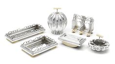 A  Josef Hoffmann for the Wiener Werkstätte silver and ivory six piece desk set