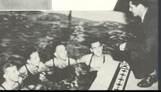 UO swimmers receiving instruction from their coach 1937-38.  From the 1938 Oregana (University of Oregon yearbook).  www.CampusAttic.com