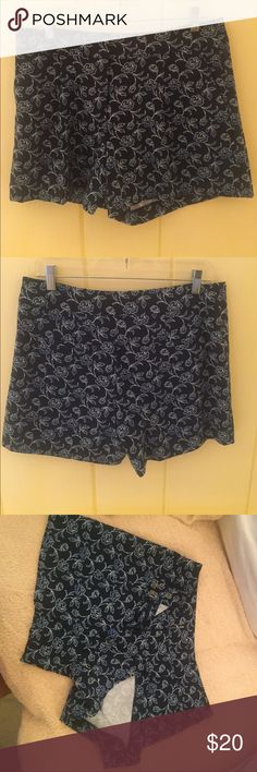 Shorts Excellent used condition, no signs of wear. Has side & back pockets. Small pleat in the front.  MATERIALS: 98% polyester and 2% spandex. MEASUREMENTS: Waist - 34 inches,  Hips - 38 inches, Leg Length - 4-1/4 inches from crotch seam. COLOR: Black, navy blue, cream Ann Taylor Shorts