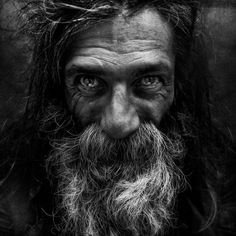 This post showcase stunning black and white portraits of homeless people taken by Lee Jeffries. He started taking homeless people photos when he met a young