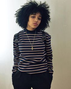 character, female, black, black hair, frizzy hair, stripes, necklace, piercing