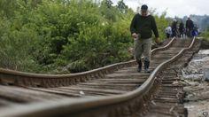 A Bosnian man walks on a damaged railway track near Tuzla 140km (87 miles) north of Sarajevo, Bosnia (17 May 2014)