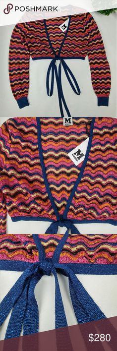 """🆕 M Missoni metallic crochet crop top BRAND NEW M Missoni metallic crochet crop top with front tie up bow. Multi color zig zag crochet. Colors are brown, blue, orange, black,pink, and gold. Size 42 Italy Size 6 USA Armpit to armpit measuring laying flat across 16.5"""" Length 13"""" Sleeve length measuring from shoulder hem line 23.5"""" The material is stretchy so it could probably work for size small and medium Missoni Tops Crop Tops"""