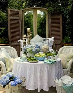 OMG~~why ruin this lovely table by not pressing the tablecloth?!  To me, it's so BADLY wrinkled, it must be on purpose! Kinda cute if you think of it that way! Way Shabby! Love.