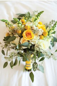 Yellow and white roses with greens, pretty bouquet.