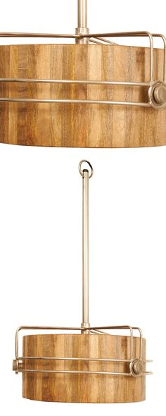 Orbited by a brass-plated frame set slightly askew, our Elroy Drum Pendant Light toes the line between cosmic and organic. A drum shade of solid mango wood brings warmth to the design, which is suspend...  Find the Elroy Drum Pendant Light, as seen in the The Distillery Collection at http://dotandbo.com/collections/the-distillery?utm_source=pinterest&utm_medium=organic&db_sku=117236