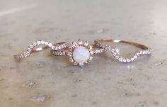 Rose Gold Opal Engagement Ring Set- Genuine Opal Engagement Ring- 14k Floral Engagement Ring- Opal Bridal Set Wedding Ring-Opal Diamond Ring by Belesas on Etsy https://www.etsy.com/uk/listing/491641199/rose-gold-opal-engagement-ring-set