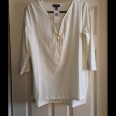 NWT blouse with lace insert & gold zipper detail. Pretty, long sleeved blouse with lace insert and gold zipper detail.  Has longer shirttail back so may be worn out or tucked in.  NWT! Allison Brittney Tops Blouses