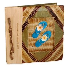 """Beach Photo Album Handmade from all natural materials Size: 7"""" x 7"""" Let the memories of your seaside adventures live on forever in this beautiful all natural Tropical Beach Photo Album. Your favorite surfside moments will look gorgeous displayed in this eco friendly album that is handmade on the island of Bali from organic material. Butterfly leaf (kupu kupu), papaya fibers, palm leaves and nutshells come together to provide only the finest creation of natural beauty. The cover of this album…"""