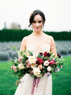 Garden style wedding bouquet in purple, pink, cream and white with garden roses, clematis, and ranunculus by Foraged Floral for Seattle, Washington wedding