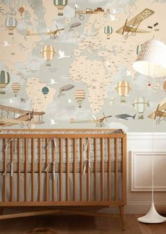 Wallpaper of a world map with hot air balloons, whales, planes, and birds. Perfect for child's room, playroom, or nursery.