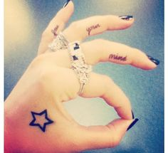 Star tattoo.