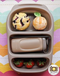 This goodbyn bynto was for morning nutrition break. The top section held a homemade blueberry muffin and a peeled clementine orange with an adorable leaf pick. The middle section held a goodbyn drinking bottle filled with milk. I placed an ice pack sheet underneath the milk to keep it ice cold. The bottom section held 3 fresh strawberries.