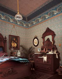 Reasons I love Victorian interiors: elaborate, carved dark wood furniture, amazing Bradbury wallpaper, great paintings hung on tasseled cords from picture rails, ferns.