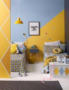 It's possible to give a shared bedroom an individual feel using cool and contemporary paint effects