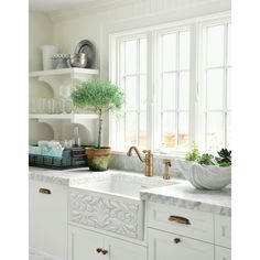 Molly Frey Design Lovely cottage kitchen design wth beadboard backsplash, white apron sink, white open shelves, white kitchen cabinets with marble counter top, French windows and polished nickel faucet. I like the open shelves! Classic Kitchen, New Kitchen, Kitchen Dining, Kitchen Decor, Kitchen White, Kitchen Shelves, Kitchen Windows, Kitchen Cabinets, Crisp Kitchen