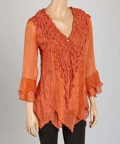 Loving this Rust Lace Silk-Blend V-Neck Tunic on #zulily! #zulilyfinds** not plus size but like the look and color