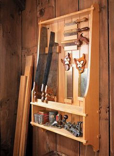 This wall-mounted case provides convenient storage for your handsaws and other treasured hand tools.
