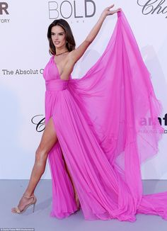 Amazing: Flirtatiously playing with the cape of her sensational number, the star also managed to show off her long lean legs as she glided along
