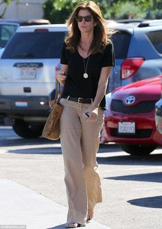 Cindy Crawford was seen running errands in  looking effortlessly chic in wide leg trousers in Malibu, California on Thursday