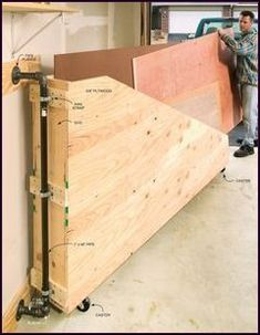 12 SwingOut Plywood Storage Popular Woodworking Magazine is part of Plywood storage - I was looking for a way to keep my small inventory of plywood organized and easy to access The garage at my town house is small, but I did have a narrow space… Plywood Storage, Lumber Storage, Lumber Rack, Wood Storage Rack, Storage Shelves, Garage Tools, Diy Garage, Garage Shop, Garage Bike