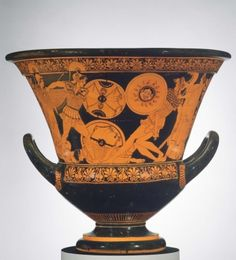 """Side A: On both sides of this krater are duels from the Trojan War. Memnon, king of Ethiopia, was an ally of the Trjojans. His death at the hands of Achilles was described in the Aethiopis, a lost epic poem. Achilles and Memnon wear corselets covered with plates of scale-armor. Achilles carries a """"Theban"""" shield, with deep, semi-circular notches; the device on the front is not visible but Memnon's shield has the head of a gorgon. Encouraged by Athena who holds out her snake-rimm..."""