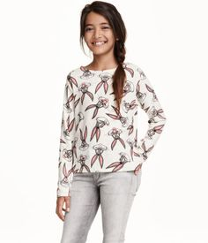 Fine-knit top in slub yarn with a printed pattern and long sleeves.