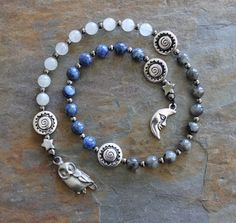 """Etsy IndigoDesertMoon Night Owl Worry Beads Prayer Beads, can be a useful tool for meditation or focusing spiritual energies. This set is comprised of Larvikite, Rainbow Moonstone and Lapis Lazuli with a sweet little owl and a silvery moon. The total length is 14"""".(¸.•´ (¸.•`* *Natural gemstone beads also help us make a connection to the earth itself. This link opens us to the Web of Life, the positive energy of Nature, and to the Divine. Using prayer beads joins us to an ancient spiritual…"""