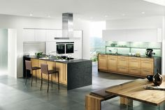Küchen sind der Mittelpunkt des Lebens. Küchenarbeitsplatten aus Naturstein von Strasser Steine verwandeln auch Ihre Küche in einen Ursprung des guten Geschmacks.
