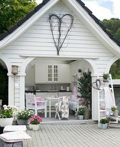 amazing outdoor kitchen; what if this was an art studio with a pull down insulated garage door?