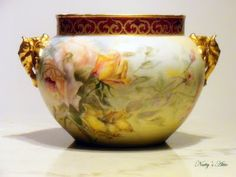 """This is a museum quality Jardiniere Limoges, hand painted with  gilded  Elephant Head handles.   """"JPL"""" limoges from France. Approximate size: W13.5"""", H7.5""""  The hand painting is superb, especially the roses all around the piece. On the neck of the Jardiniere, it has gold decorated trim as an accent. Circa: 1849~1904"""