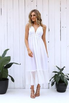 Under $100    LOST IN LUNAR ELLETTE MAXI DRESS IN WHITE Channel your inner bohemian goodness with the Ellette Maxi Dress. This backless style features a halter tie top, deep V neckline, ruched bust detail and spotted tulle hem. #bohostyle #springfashion
