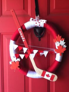If you think wreaths are just reserved for holidays like Christmas and Thanksgiving, we urge you to think again! Put your Canada love on display with your own homemade wreath that shows off everything you love most about the True North Strong and Free. Canada Day 150, Happy Canada Day, Canadian Christmas, Christmas In July, Canadian Thanksgiving, Toronto Canada, Alberta Canada, Diy Projects To Try, Craft Projects