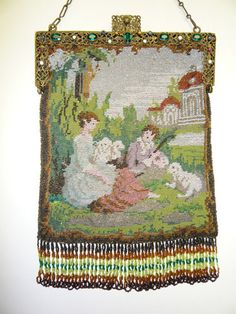 Beaded pastoral scenic: youth figures tending sheep.  Jeweled frame, coordinating fringe, silk lining.