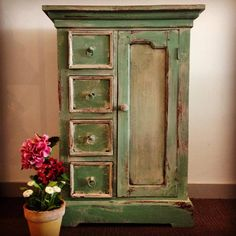A beautiful wardrobe finished in Chalk Paint® decorative paint by Annie Sloan in Old Ochre and a mix of Antibes Green and Louis Blue. Craqueleur and Dark Wax helped give this piece an aged and distressed finish | By stockist Mon Petit Palais Designs in Western Australia
