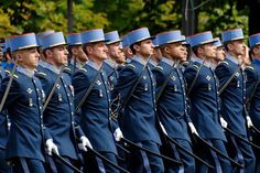 """EMIA cadets in parade uniform, during the Bastille Day Military Parade. EMIA stands for """"Ecole Spéciale Militaire de Saint-Cyr"""", which is the French West Point. French students who enter the École Spéciale Militaire de Saint-Cyr as cadets are about 21 years old, and undergo three years of training. Note that all the cadets in the photo wear the paratrooper's badge for which they qualify before graduation as commissioned officers."""