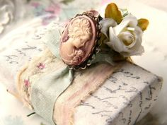 Shabby chic gift wrapped in ribbon and roses