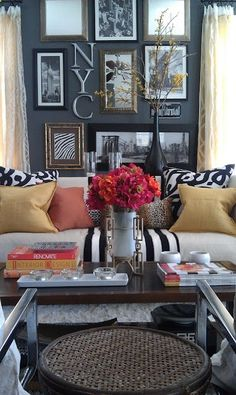 Love everything about this... gallery wall, dark grey wall, mustard yellow accents with bold black and white! Yes