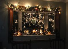 Pretty much how I decorate my bay window for Christmas. Like the idea of adding lit garland to top.