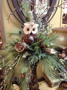 Woodsy owl floral centerpiece using a candleholder for elevation. My Big Day Events, Colorado