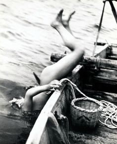 A Japanese 'Ama' (female diver) goes overboard in search of shellfish in the 1930s, Japan. °