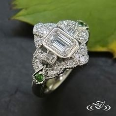 Art Deco Ring featuring Green Garnets and an Emerald Cut Diamond #Roaring20's