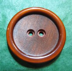 "1 - 1 & 3/8"" DECORATIVE RUST BROWN PLASTIC 2-HOLE BUTTON - Lot#T135"
