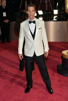 Matthew McConaughey advances the cause of the ivory dinner jacket in Dolce&Gabbana, with black vest, tie and pants.