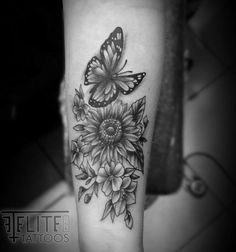 Flowers and butterfly tattoo done by Allen P at #eliteinktattoos in #myrtlebeach
